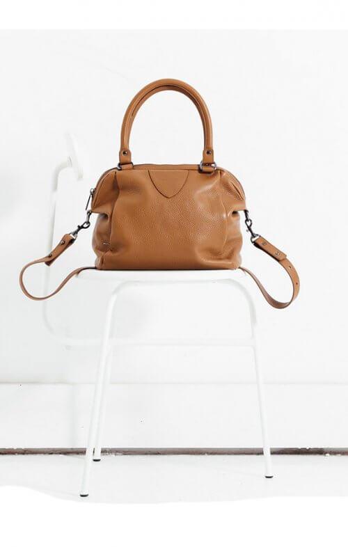 status anxiety force of being handbag tan6