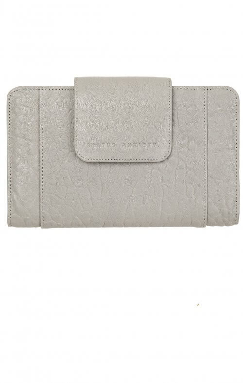 status anxiety precipice wallet cement