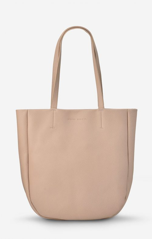 status anxiety appointed leather bag